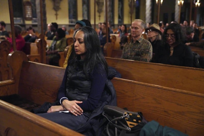 In this Feb. 9, 2020 photo, people attend an Evensong sound bath meditation service at All Saints Episcopal Church in the Brooklyn borough of New York. The contemplative service uses music, candles and incense to create an oasis of calm so people can sit quietly in communion. (AP Photo/Emily Leshner)
