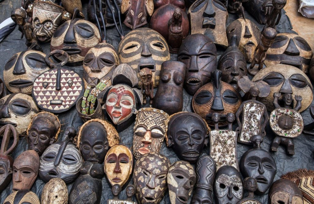 African masks on display at a market in Nairobi, Kenya, in May 2015. Photo by Ninaras/Creative Commons