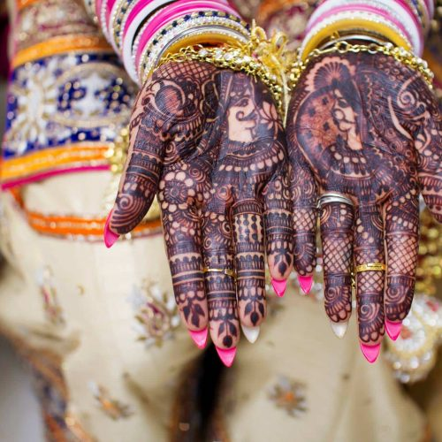 Hannaed hands at Sikh wedding  Photo by Natalie Baxter